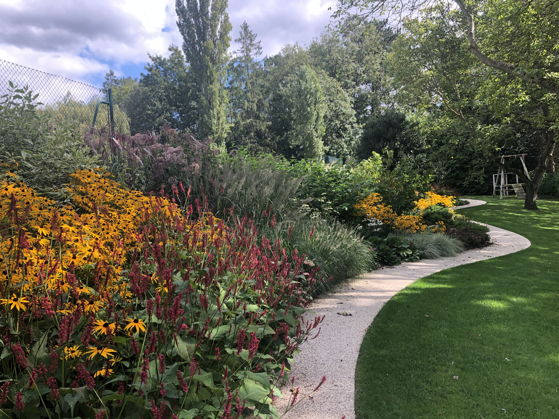Full Vibrant Planting on winding path, London
